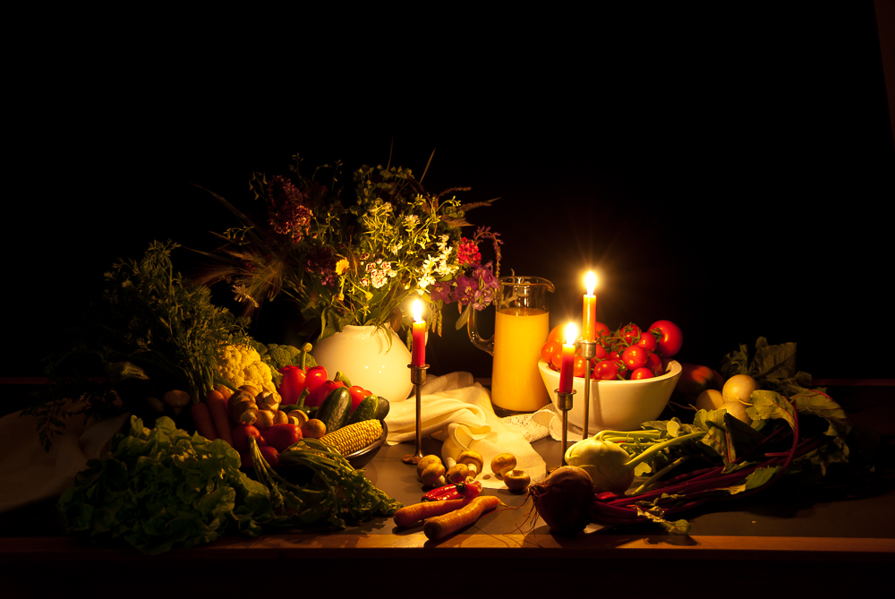 a still life photography (vegetables in candlelight)