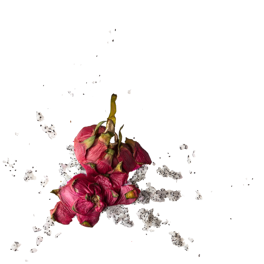 a minimalistic picture aesthetically showing a smashed dragonfruit on pure white ground (no shadow)