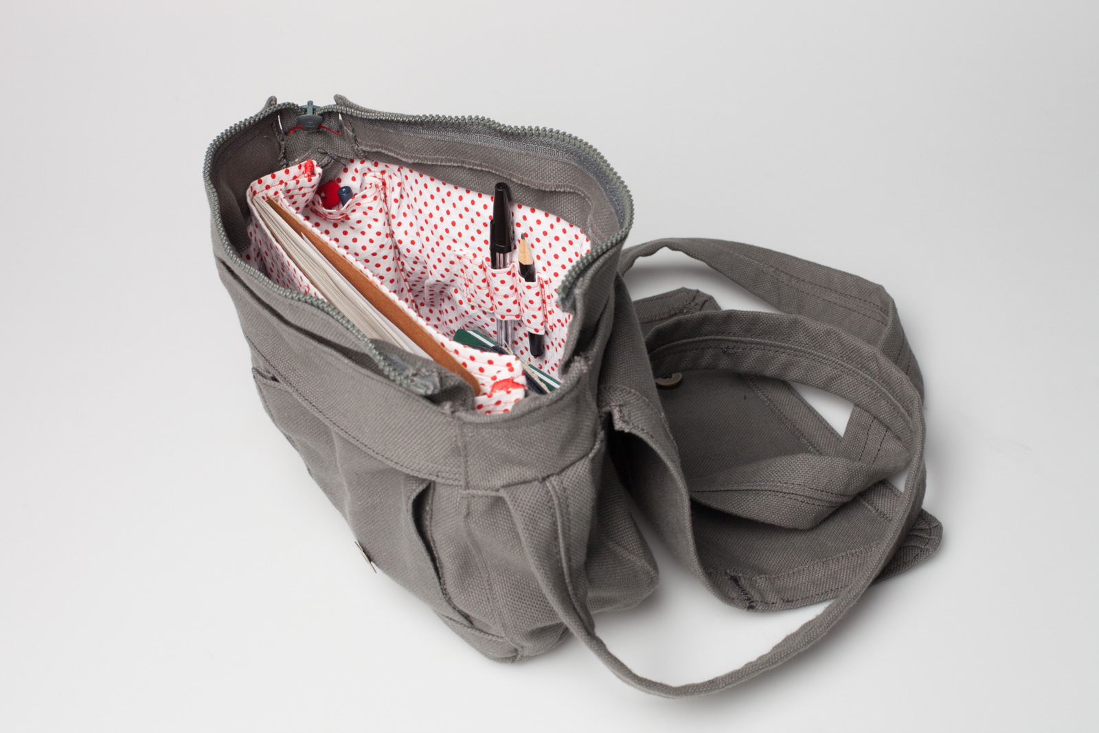 a simple fabric handbag – open, you can see the white with red dots inlay and a few pens and books on the inside