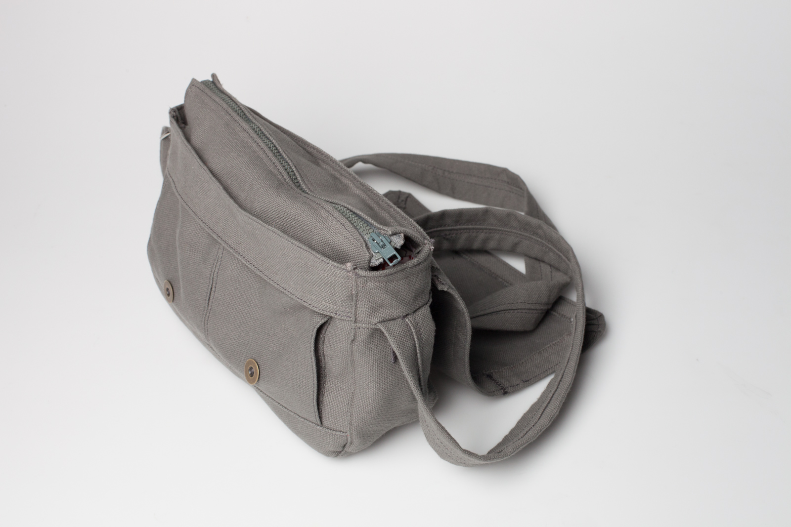 the closed grey fabric handbag