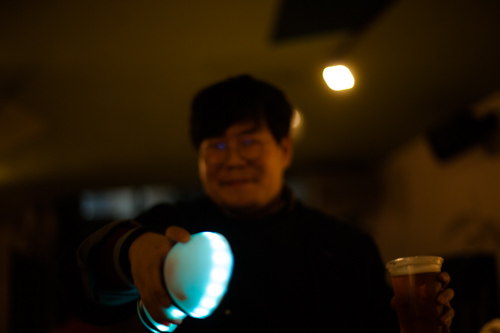 happy asian guy holding motion karoke (out of focus)